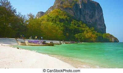Handmade Wooden Tour Boats Line a Tropical Beach - FullHD...