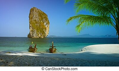 Handmade Wooden Tour Boats Waiting at Railay Beach in Thailand