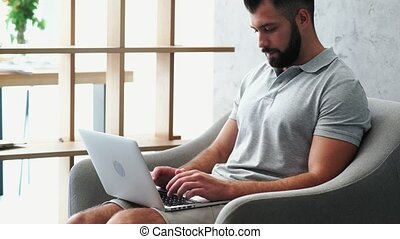 Handosome bearded man working from home