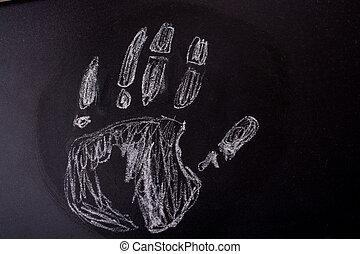 Handprint drawn by chalk on a blackboard