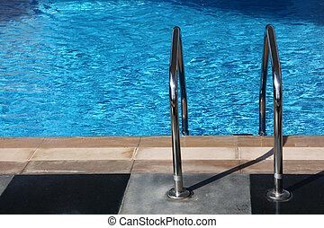 Handrails On Side Of A Crystal Clear Water Pool