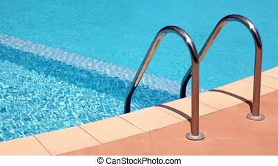 Handrails to stairs leading to swimming pool, undulating...