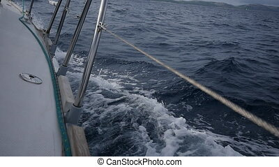 Handrails yacht on background of sea waves in Greece. Close-up.