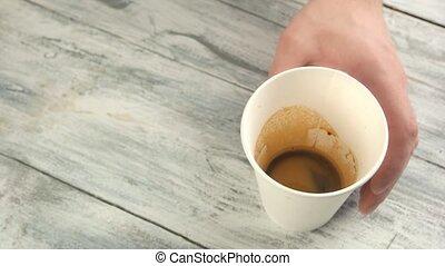 Hands adding milk to espresso. Person making latte.