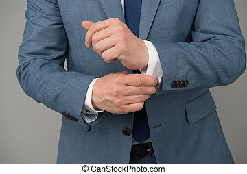 Hands adjusting sleeves formal suit business outfit, ...
