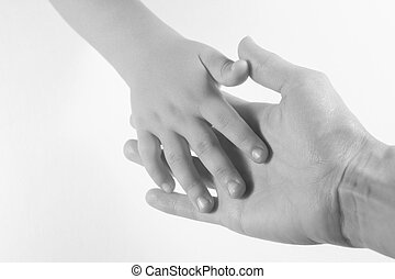 Adult and child with hands touching. Black and white image on a white background.