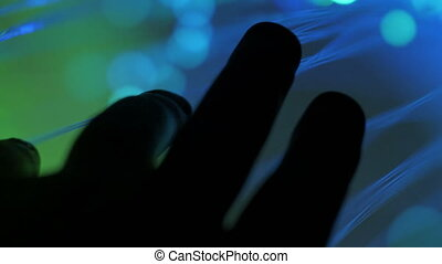 Hands against fiber optics
