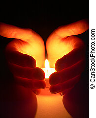 Hands and a candle - Hands cupped around a candle