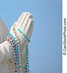 hands and beads