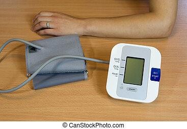 hands and digital blood pressure measurement