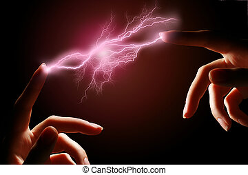 Hands and electric discharge.