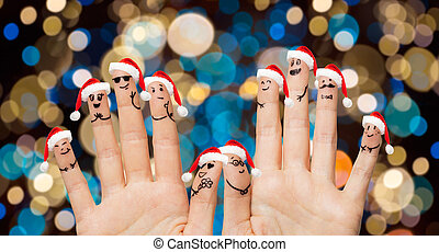 hands and fingers in santa hats at christmas - christmas,...