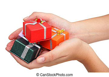 Hands and Gifts - Female hands holding small gifts over...