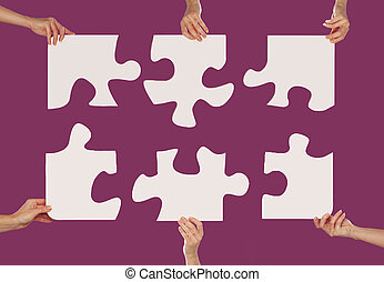 Hands and puzzle