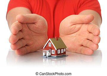 Hands and small house.