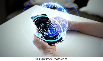 hands and smartphone with virtual earth hologram -...
