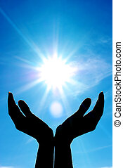 Hands and sun. Conceptual design.