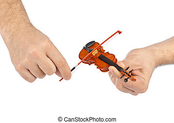 Hands and toy violin
