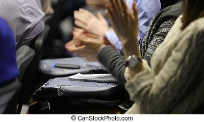 hands applauding at a conference