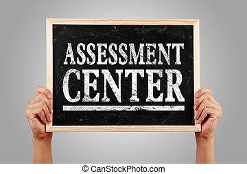 Assessment center - Hands are holding the blackboard of ...