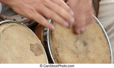 Hands Banging Bongo Drums