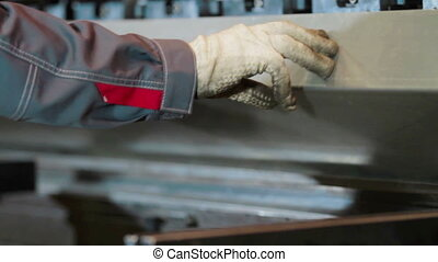 Hands bend sheet metal worker in the factory - hands that...