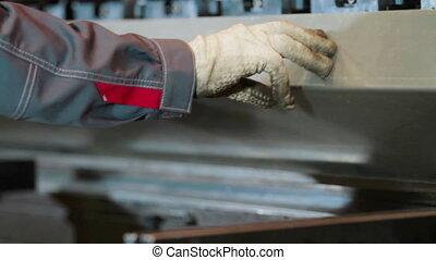 Hands bend sheet metal worker in the factory