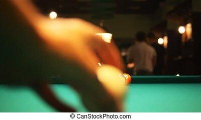 hands break balls on biliards table