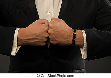 Hands bump fists. Fists clash with power. Punches of businessman. Conflict concept. confrontation and competition in business