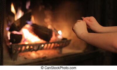 Hands by the fireplace