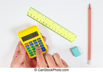 Hands calculate using a calculator over workplace of the engineer