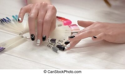 Hands choose purple color, slow motion. Young woman...