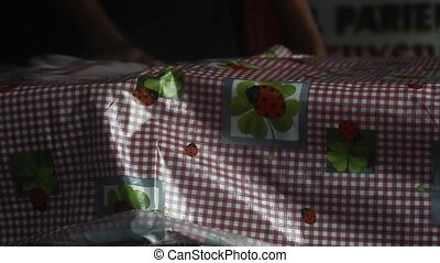 Hands cleaning table - Hands cleaning plastic tablecloth in ...