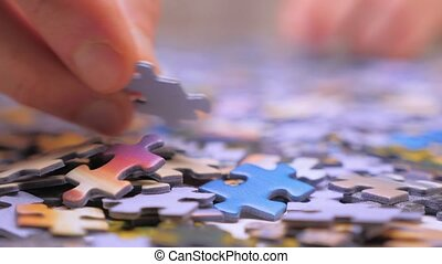 Finding the solution concept. Hand matching jigsaw halves. Leisure activity. Achieving the goal step by step. Engaging in successful work finding business solution, corporate unity