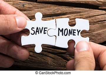 Hands Connecting Save Money Jigsaw Pieces