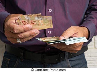 counting cash banknotes, Brazil Currency. Financial, profit, credit, cost, purchase, rich concept