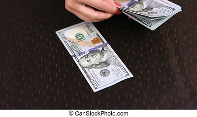 hands counting dollar - woman hands counting dollar notes,...