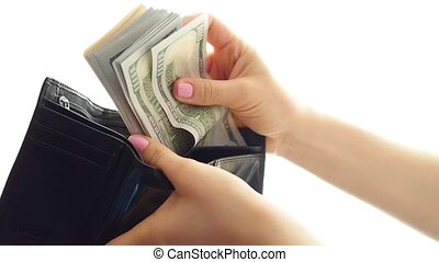 hands counting money and put in a wallet closeup
