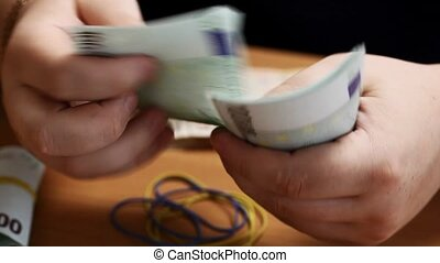 Hands counting money
