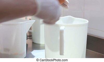 hands cracking eggs