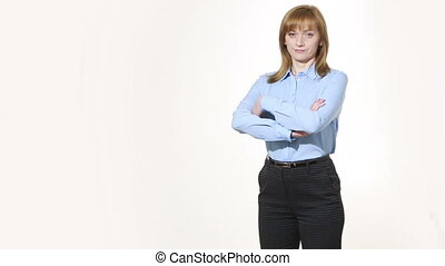 hands crossed on his chest. barrier closed, discontent. girl in pants and blous.  Isolated on white background. body language. women gestures. nonverbal cues