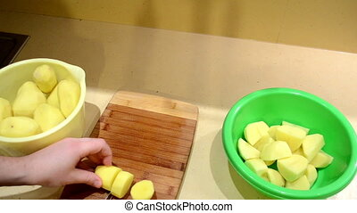 hands cut potato knife