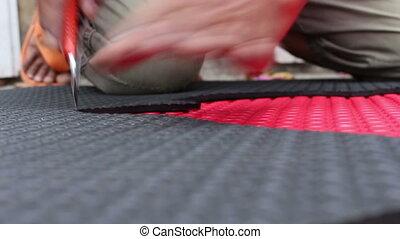hands cutting EVA foam
