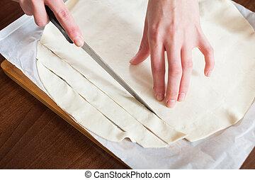 hands cutting store-bought dough