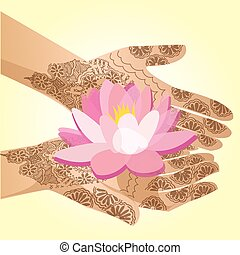 Hands decorated with henna indian woman holding a lotus flower.