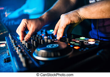 hands dj dj hands on equipment deck and mixer with vinyl record at