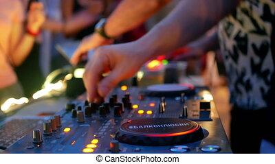 Hands DJ plays music - Close up of hands of DJ plays music...