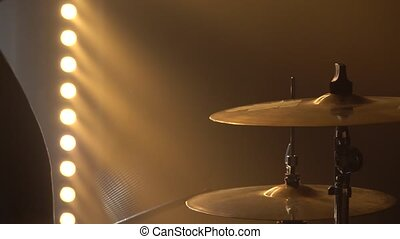 Hands drummer playing on drum kit on stage in a dark studio with smoke and neon lighting. Dynamic neon lighting effects. Performance vocal and musical band. Close up