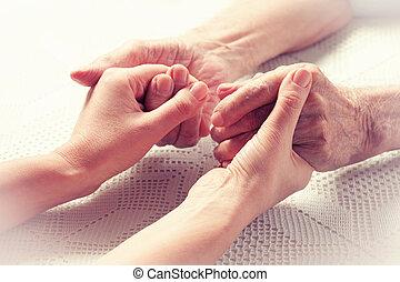 Hands elderly man. - Senior man, woman with their caregiver...