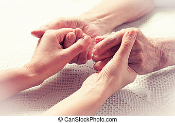 Hands elderly man. - Senior man, woman with their caregiver...